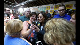 Presidential candidate U.S. Sen. Kamala Harris, D-Calif., greets supporters during a campaign stop at Convivium Urban Farmstead in Dubuque on Monday, June 10, 2019. (Eileen Meslar/Telegraph Herald via AP)
