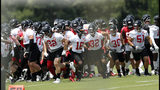 Atlanta Falcons break a huddle during their NFL football practice Tuesday, June 11, 2019, in Flowery Branch, Ga. (AP Photo/John Bazemore)