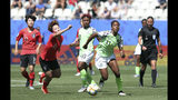 South Korea's Jung Seol-bin, left, challenges Nigeria's Chinaza Uchendu during the Women's World Cup Group A soccer match between Nigeria and South Korea in Grenoble, France, Wednesday June 12, 2019.(AP Photo/Laurent Cipriani)