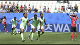 Nigeria players celebrate after taking the lead after South Korea's Kim Do-yeon scored an own goal during the Women's World Cup Group A soccer match between Nigeria and South Korea in Grenoble, France, Wednesday June 12, 2019.(AP Photo/Laurent Cipriani)