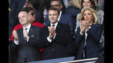 From left, FIFA President Gianni Infantino, French President Emmanuel Macron, and wife Brigitte Macron clap their hands prior to the start of the Group A soccer match between France and South Korea on the occasion of the Women's World Cup at the Parc des Princes in Paris, Friday, June 7, 2019. (AP Photo/Francisco Seco)