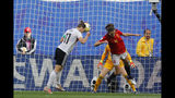 Germany's Alexandra Popp, left, heads the ball against Spain's Irene Paredes, right, and Spain goalkeeper Sandra Panos, background, before teammate Germany's Sara Daebritz scored the opening goal during the Women's World Cup Group B soccer match between Spain and Germany at Stade du Hainau in Valenciennes, France, Wednesday, June 12, 2019. (AP Photo/Michel Spingler)