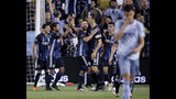LA Galaxy forward Zlatan Ibrahimovic (9) celebrates with teammates after scoring a goal during the second half of an MLS soccer match against the Sporting Kansas City Wednesday, May 29, 2019, in Kansas City, Kan. LA Galaxy won 2-0. (AP Photo/Charlie Riedel)