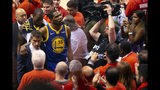 Golden State Warriors forward Kevin Durant glances up at the stands as he walks off the court after sustaining an injury during first half basketball action in Game 5 of the NBA Finals in Toronto, Monday, June 10, 2019. (Chris Young/The Canadian Press via AP)