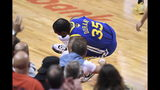 Golden State Warriors forward Kevin Durant (35) goes down with a leg injury against the Toronto Raptors during first half action in Game 5 of the NBA Finals in Toronto on Monday, June 10, 2019. (Frank Gunn/The Canadian Press via AP)