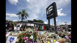 FILE - In this July 11, 2016, file photo, a makeshift memorial continues to grow outside the Pulse nightclub in Orlando, the day before the one month anniversary of a mass shooting, in Orlando, Fla. Floridians and others around the world are remembering the three-year anniversary of a massacre at the Pulse nightclub that left 49 people dead. Florida Gov. Ron DeSantis issued a proclamation for Wednesday, June 12, 2019 ordering state flags to be lowered to half-staff and asking Floridians to remember the victims of the shooting. (AP Photo/John Raoux, File)
