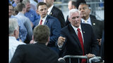 In this June 6, 2019, photo, Vice President Mike Pence meets with attendees at JLS Automation in York, Pa. (AP Photo/Matt Rourke)