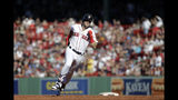 Boston Red Sox's Andrew Benintendi rounds second with an RBI-triple against the Texas Rangers in the third inning of a baseball game at Fenway Park, Wednesday, June 12, 2019, in Boston. (AP Photo/Elise Amendola)