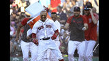 Boston Red Sox's Mookie Betts is doused by teammates after drawing a game-ending walk that gave the team a 4-3 win against the Texas Rangers in a baseball game at Fenway Park, Wednesday, June 12, 2019, in Boston. (AP Photo/Elise Amendola)