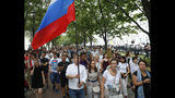 Supporters of Russian investigative journalist Ivan Golunov and other protesters gather to attend a march in Moscow, Russia, Wednesday, June 12, 2019. (AP Photo/Pavel Golovkin)