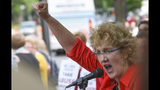 Christa Brown, of Denver, Colo., speaks outside the Southern Baptist Convention's annual meeting Tuesday, June 11, 2019, during a rally in Birmingham, Ala. (AP Photo/Julie Bennett)