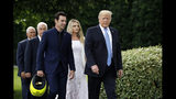 President Donald Trump walks with driver Simon Pagenaud to the South Lawn at the White House, Monday, June 10, 2019, in Washington for an event to honor Team Penske for the 2019 Indianapolis 500 win. Walking behind Trump are Vice President Mike Pence, from back left, team owner Roger Penske and Pagenaud's fiancee Hailey McDermott. (AP Photo/Patrick Semansky)