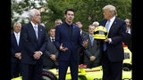 Driver Simon Pagenaud, center, speaks in front of team owner Roger Penske, left, and President Donald Trump on the South Lawn at the White House, Monday, June 10, 2019, in Washington during an event to honor Team Penske for the 2019 Indianapolis 500 win. (AP Photo/Patrick Semansky)