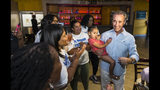 Joe Morrissey, right, with his daughter Bella, 3, celebrates his Democratic primary win in 16th District State Senate race with his supporters at the election party of Plaza Mexico in Petersburg, Va., Tuesday, June 11, 2019. (Daniel Sangjib Min/Richmond Times-Dispatch via AP)