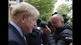 British Conservative Party lawmaker Boris Johnson leaves his home in London, Thursday, June 13, 2019. Boris Johnson, who ran London as mayor for eight years until 2016 and then became Britain's foreign secretary until his resignation last summer, is a confident if erratic Conservative Party star with a simple message: I'll sort out Brexit. (AP Photo/Frank Augstein)