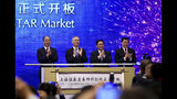 """From left; Yi Huiman, Chairman of China Securities Regulatory Commission, Chinese Vice Premier Liu He, Shanghai Party Secretary Li Qiang, Shanghai mayor and Ying Yong applaud during a ceremony for the launch of the SSE STAR Market, previously referred to as the Shanghai Science and Technology Innovation Board, in Shanghai, Thursday, June 13, 2019. Chinese media say the country's top trade negotiator has told a forum in Shanghai that """"external pressures"""" can help the economy. (Chinatopix via AP)"""
