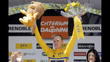 "FILE - In this Friday, June 7, 2013 file photo, Britain's Christopher Froome of the Sky Procycling team celebrates with the yellow jersey on the podium after the sixth stage of the 65th Dauphine cycling race between La Lechere and Grenoble, French Alps. Four-time Tour de France winner Chris Froome will miss this year's race after a ""bad crash"" in training on Wednesday June 12, 2019. Team INEOS leader Dave Brailsford said Froome sustained a suspected fractured femur in a 60 kph (40 mph) crash. (AP Photo/Laurent Cipriani, File)"