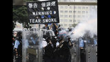 FILE - In this file photo taken Wednesday, June 12, 2019, police fire tear gas towards protesters outside the Legislative Council in Hong Kong. Hong Kong police have resorted to harsher-than-usual tactics to suppress protesters this week in the city's most violent turmoil in decades. Police fired rubber bullets and beanbag rounds at the crowds, weapons that have not been widely used in recent history. (AP Photo/Vincent Yu, File)