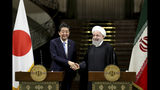 Japanese Prime Minister Shinzo Abe, left, and Iranian President Hassan Rouhani shake hands after their joint press conference at the Saadabad Palace in Tehran, Iran, Wednesday, June 12, 2019. The Japanese leader is in Tehran on an mission to calm tensions between the U.S. and Iran. (AP Photo/Ebrahim Noroozi)
