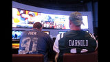In this Sept. 9, 2018 photo, customers watch sports on a giant screen at the sports book of the Ocean Resort Casino in Atlantic City, N.J. Panelists at a gambling conference in Atlantic City, on Thursday, June 13, 2019, predicted 90 percent of all US sports betting will be done online or over smart phones within the next 10 years. (AP Photo/Wayne Parry)