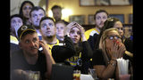 Boston Bruins fans react as the St. Louis Blues score a goal, as the fans watch television coverage of Game 7 of the NHL hockey Stanley Cup Final on Wednesday, June 12, 2019, at a bar in Boston. (AP Photo/Steven Senne)