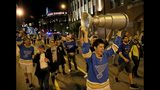 "Joel Glasscock, from Belleville, Ill., marches down a St. Louis street Wednesday night, June 12, 2019, with a model of the Stanley Cup he made, after the Blues defeated the Boston Bruins in Game 7 of the NHL hockey Stanley Cup Final in Boston. ""I made it a month ago. I had a feeling this year was different,"" said Glasscock about his homemade Cup. (David Carson/St. Louis Post-Dispatch via AP)"