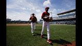 Arkansas' Curtis Washington, Jr., right, and Casey Martin head to the dugout during practice for baseball's College World Series at TD Ameritrade Park, Friday, June 14, 2019, in Omaha, Neb. (Ryan Soderlin/Omaha World-Herald via AP)