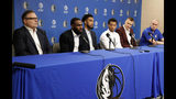 FILE - In this Feb. 4, 2019, file photo, Dallas Mavericks President of Basketball Operations, Donnie Nelson, from left, Tim Hardaway Jr., Courtney Lee, Trey Burke, Kristaps Porzingis and head coach Rick Carlisle, right, listen as Hardaway responds to a questions during a news conference where the newly acquired players were introduced in Dallas. The roots of Donnie Nelson's discovery of Dirk Nowitzki came from the sister country of one of the two young Euro stars the Mavericks hope will help lead them into a new age of prosperity now that the big German has retired after a record 21 seasons with the same franchise. The Dallas personnel boss became one of the pioneers of European scouting by helping make Lithuania relevant on the world stage. Now that he has paired Latvia's Kristaps Porzingis with first-year phenom Luka Doncic, Nelson figures to be a spectator for most of Thursday's NBA draft, an event that has had an international flavor for years. (AP Photo/Tony Gutierrez, File)