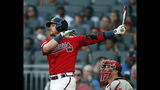 Atlanta Braves' Josh Donaldson follows through on a solo home run next to Philadelphia Phillies catcher J.T. Realmuto during the the second inning of a baseball game Friday, June 14, 2019, in Atlanta. (AP Photo/John Bazemore)