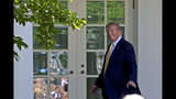 President Donald Trump leaves after speaking in the Rose Garden of the White House, Friday, June 14, 2019, in Washington. (AP Photo/Jose Luis Magana)