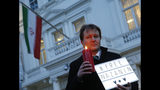 "FILE - In this Jan. 16, 2017 file photo, Richard Ratcliffe, husband of imprisoned charity worker Nazanin Zaghari-Ratcliffe, poses for the media during a vigil outside the Iranian Embassy in London. Richard Ratcliffe said Saturday June 15, 2019, that Nazanin Zaghari-Ratlciffe had told Iranian judicial officials that she will refuse food but will drink water until she is granted ""unconditional release."" (AP Photo/Alastair Grant, File)"
