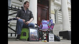 "Richard Ratcliffe starts a protest outside the Iranian Embassy in London Saturday June 15, 2019, where he is on hunger strike in solidarity with his wife, Nazanin Zaghari-Ratcliffe, who has informed the Iranian judiciary she had stopped taking food in protest at her ""unfair imprisonment"" in Evin Prison in Iran. British-Iranian woman Nazanin Zaghari-Ratcliffe, jailed in Tehran for more than three years has begun a hunger strike to protest her detention, her husband said Saturday, who will also fast in support of his wife.(Jonathan Brady/PA via AP)"
