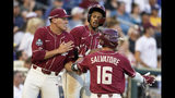 Florida State's J.C. Flowers, center, celebrates with Mike Salvatore (16) and Cj Van Eyk, left, after scoring the go-ahead and winning run against Arkansas on a sacrifice fly by Nander De Sedas in the ninth inning of an NCAA College World Series baseball game in Omaha, Neb., Saturday, June 15, 2019. (AP Photo/Nati Harnik)