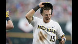 Michigan's Jimmy Kerr (15) celebrates after scoring against Texas Tech on an RBI-single by Blake Nelson, in the third inning of an NCAA College World Series baseball game in Omaha, Neb., Saturday, June 15, 2019. (AP Photo/Nati Harnik)