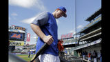 New York Mets 2019 first round pick Brett Baty, a third baseman from Lake Travis High School in Austin, Texas, heads into the dugout after taking batting practice prior to a baseball game against the St. Louis Cardinals, Saturday, June 15, 2019, in New York. (AP Photo/Julio Cortez)