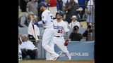 Los Angeles Dodgers' Alex Verdugo, right, and Cody Bellinger smile after Verdugo's solo home run against the Chicago Cubs during the fourth inning of a baseball game in Los Angeles, Saturday, June 15, 2019. (AP Photo/Alex Gallardo)