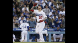Los Angeles Dodgers' Alex Verdugo points skyward after hitting a solo home run against the Chicago Cubs during the fourth inning of a baseball game in Los Angeles, Saturday, June 15, 2019. (AP Photo/Alex Gallardo)