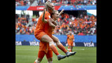 Netherlands' scorer Vivianne Miedema, right, and her teammate Netherlands'Jill Roord, left, celebrate their side's 3rd goal during the Women's World Cup Group E soccer match between the Netherlands and Cameroon at the Stade du Hainaut in Valenciennes, France, Saturday, June 15, 2019. The Netherlands defeated Cameroon by 3-1. (AP Photo/Michel Spingler)