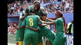Cameroon's players celebrate their side's first goal scored by Gabrielle Aboudi Onguene during the Women's World Cup Group E soccer match between the Netherlands and Cameroon at the Stade du Hainaut in Valenciennes, France, Saturday, June 15, 2019. (AP Photo/Michel Spingler)