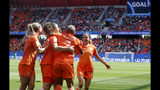 Netherlands' players celebrate their side's 2nd goal scored by Dominique Bloodworth, 2nd left, during the Women's World Cup Group E soccer match between the Netherlands and Cameroon at the Stade du Hainaut in Valenciennes, France, Saturday, June 15, 2019. (AP Photo/Michel Spingler)