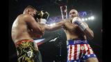 Tyson Fury, of England, hits Tom Schwarz, of Germany, during a heavyweight boxing match Saturday, June 15, 2019, in Las Vegas. (AP Photo/John Locher)