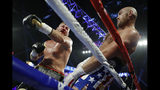 Tyson Fury, of England, right, dodges a punch by Tom Schwarz, of Germany, during a heavyweight boxing match Saturday, June 15, 2019, in Las Vegas. (AP Photo/John Locher)