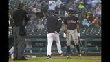 Detroit Tigers manager Ron Gardenhire kicks at the dirt near Cleveland Indians' Oscar Mercado after being ejected by home plate umpire Manny Gonzalez during the sixth inning of a baseball game in Detroit, Saturday, June 15, 2019. (AP Photo/Paul Sancya)