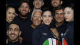 Designer Giorgio Armani, centre, poses with Italian Olympic athletes at the end of the Emporio Armani men's Spring-Summer 2020 collection, unveiled during the fashion week, in Milan, Italy, Saturday, June 15, 2019. (AP Photo/Luca Bruno)