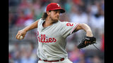 Philadelphia Phillies' Aaron Nola pitches against the Atlanta Braves during the first inning of a baseball game Saturday, June 15, 2019, in Atlanta. (AP Photo/John Amis)