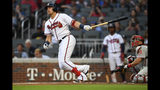 Atlanta Braves' Austin Riley watches his home run during a the second inning of baseball game against the Philadelphia Phillies, Saturday, June 15, 2019, in Atlanta. (AP Photo/John Amis)