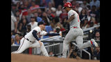 Philadelphia Phillies' Nick Williams, right, cannot beat the throw from Atlanta Braves catcher Tyler Flowers to first baseman Freddie Freeman, left, for an out during the fifth inning of a baseball game Saturday, June 15, 2019, in Atlanta. (AP Photo/John Amis)