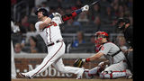 Atlanta Braves' Josh Donaldson, left, watches his three-run home run during the fifth inning of a baseball game against the Philadelphia Phillies, Saturday, June 15, 2019, in Atlanta. (AP Photo/John Amis)
