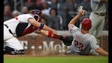 Philadelphia Phillies' Jay Bruce (23) is out at home plate after being tagged by Atlanta Braves catcher Tyler Flowers, left, while trying to score on a line drive double to right field by Scott Kingery during the third inning of a baseball game Saturday, June 15, 2019, in Atlanta. (AP Photo/John Amis)