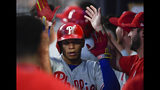 Philadelphia Phillies second baseman Cesar Hernandez is congratulated in the dugout after hitting a home run during the fourth inning of a baseball game against the Atlanta Braves, Saturday, June 15, 2019, in Atlanta. (AP Photo/John Amis)